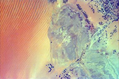 This image from NASA's EarthKAM shows pivot irrigation near the city of As Sulayyil (Sulayel), Saudi Arabia. The edge of the Rub' al-Khali or Empty Quarter is visible in the southeast.