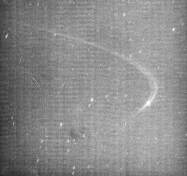 This image from NASA's Cassini spacecraft reveals the existence of a faint arc of material orbiting with Saturn's small moon Anthe.