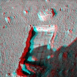 The robotic arm on NASA's Phoenix Mars Lander enlarged a trench beside a rock called 'Headless' on Sept. 20, 2008 in preparation for sliding the rock into the trench. 3D glasses are necessary to view this image.