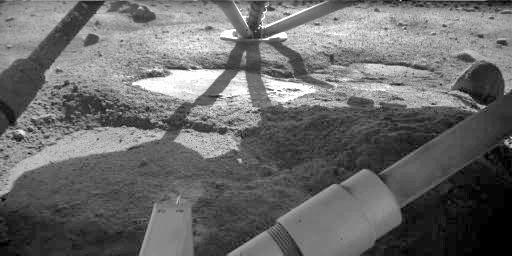 The Robotic Arm Camera on NASA's Phoenix Mars Lander took this image on Oct. 18, 2008. The flat patch in the center of the image has the informal name 'Holy Cow,' based on researchers' reaction when they first saw it.
