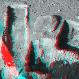 The Surface Stereo Imager on NASA's Phoenix Mars Lander took this anaglyph on Oct. 21, 2008; the trench on the upper left is called 'Upper Cupboard.' 3D glasses are necessary to view this image.