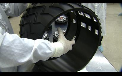 Each of the six wheels for NASA's Mars Science Laboratory rover is about half a meter (20 inches) in diameter.