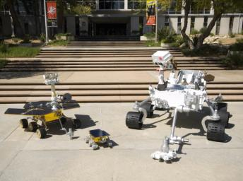 Full-scale models of three generations of NASA Mars rovers show the increase in size from the Sojourner rover of the Mars Pathfinder project, to the twin Mars Exploration Rovers Spirit and Opportunity, to the Mars Science Laboratory rover.