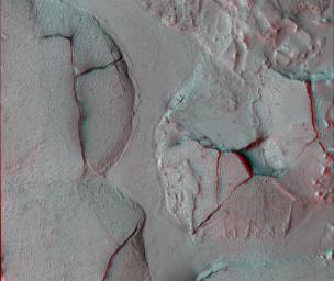 This stereo view shows fractured mounds on the southern edge of Elysium Planitia on Mars. It combines two images from NASA's Mars Reconnaissance Orbiter. 3D glasses are necessary to view this image.