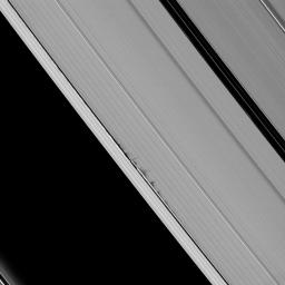 Jagged looking shadows stretch away from vertical structures of ring material created by the moon Daphnis in this image taken as Saturn approaches its August 2009 equinox.