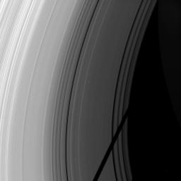 The shadow of the moon Tethys cuts across the C ring in this image taken as Saturn approaches its August 2009 equinox.