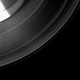 The Cassini spacecraft shows a section of Saturn and its rings which includes a special treat made possible as the planet approaches its August 2009 equinox: the shadow of a moon cast on the rings.