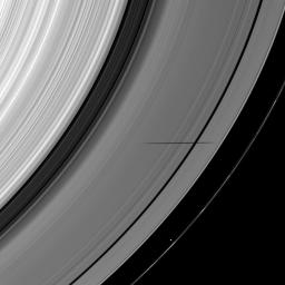 The shadow of the moon Janus crosses the Encke Gap as it strikes the plane of Saturn's rings in this image taken as the planet approached its August 2009 equinox.