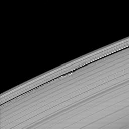 Waves in the edges of the Keeler gap in Saturn's A ring, created by the embedded moon Daphnis, show considerable complexity in this image taken as Saturn approached its August 2009 equinox.
