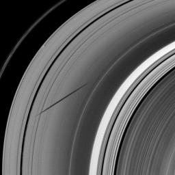 The shadow of the moon Janus dwarfs the shadow of Daphnis on Saturn's A ring in this image taken as the planet approached its August 2009 equinox.