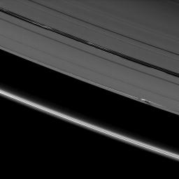Vertical ring structures created by the moon Daphnis cast dark shadows on Saturn's A ring in this image taken as the planet approached its August 2009 equinox.