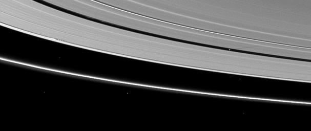 Moon shadows are cast on Saturn's A ring in this image taken by NASA's Cassini Orbiter almost a month after the planet's August 2009 equinox.