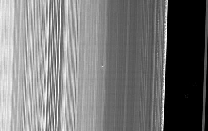 The Cassini spacecraft captured this image of a small object in the outer portion of Saturn's B ring casting a shadow on the rings as Saturn approaches its August 2009 equinox.