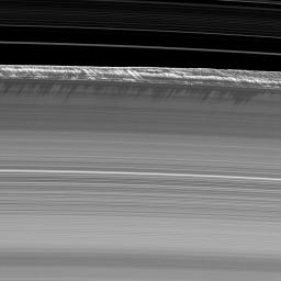 Vertical structures, among the tallest seen in Saturn's main rings, rise abruptly from the edge of Saturn's B ring to cast long shadows on the ring in this image taken by NASA's Cassini spacecraft two weeks before the planet's August 2009 equinox.