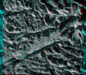 This anaglyph from images captured by NASA's Cassini spacecraft shows a dramatic, 3-D view of one of the deep fractures nicknamed 'tiger stripes' on Saturn's moon Enceladus which are located near the moon's south pole, spray jets of water ice.