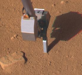 This image taken by NASA's Phoenix Mars Lander shows the lander's Thermal and Electrical Conductivity Probe, at the end of the Robotic Arm, on July 11, 2008.