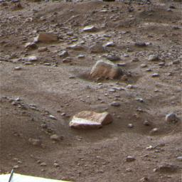 This is a false color image of the Martian terrain and rock called 'Winkies' taken by NASA's Phoenix Mars Lander Oct. 27, 2008. This frosty image is among the last taken by the lander before the mission's final communications on Nov. 2, 2008.
