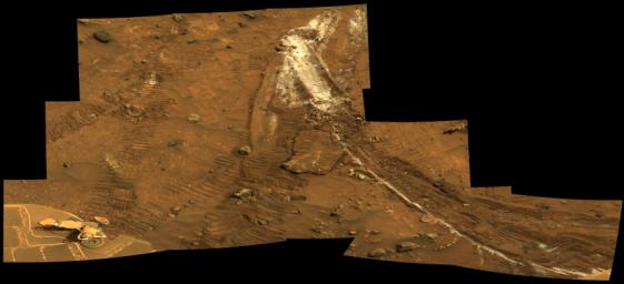 Rover�s Wheel Churns Up Bright Martian Soil