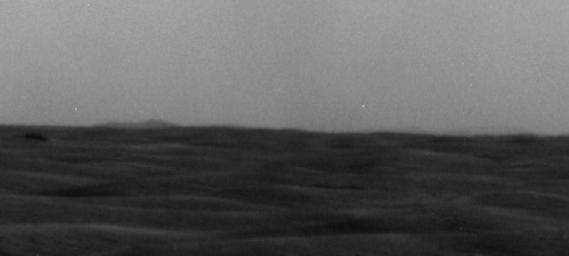 A western portion of Endeavour Crater is visible on the horizon of this image taken by NASA's Mars Exploration Rover Opportunity on March 7, 2009.