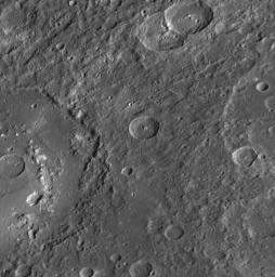 The large crater extending out the left side of this image is Praxiteles.  Named for the ancient Greek sculptor of the 4th century BC, Praxiteles  crater was first observed by Mariner 10.