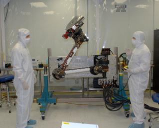 Engineers from NASA Jet Propulsion Laboratory and Alliance Spacesystems are testing the range of motion of the Mars Science Laboratory rover�s robotic arm joints.