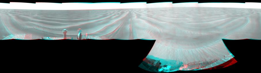 NASA's Opportunity had driven 72.3 meters southward (237 feet) on June 10. Engineers drove the rover backward as a strategy to counteract an increase in the amount of current drawn by the drive motor of the right-front wheel. 3D glasses are necessary.