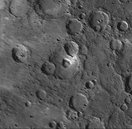 This MESSENGER NAC shows a crater at the center of this image contains a large, nearly circular pit crater.