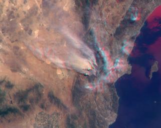 NASA's Terra satellite took this anaglyph of several pyrocumulus clouds, created by the Station Fire, visible above the smoke plumes rising from the San Gabriel Mountains north of Los Angeles. 3D glasses are necessary to view this image.
