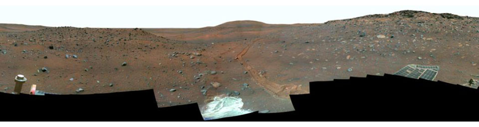 This full-circle, false color view from the panoramic camera (Pancam) on NASA's Mars Exploration Rover Spirit shows the terrain surrounding the location called 'Troy,' where Spirit became embedded in soft soil during the spring of 2009.
