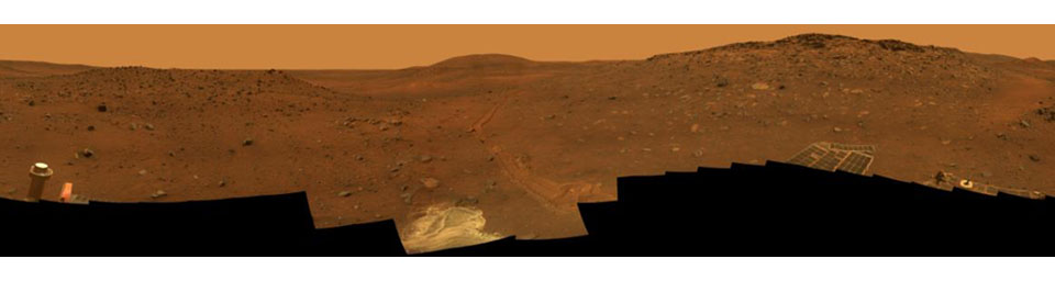 This full-circle,stereo view from the panoramic camera (Pancam) on NASA's Mars Exploration Rover Spirit shows the terrain surrounding the location called 'Troy,' where Spirit became embedded in soft soil during the spring of 2009.