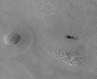 The Context Camera aboard NASA's Mars Reconnaissance Orbiter discovers new dark spots on Mars that, upon closer examination, turn out to be brand new impact craters.