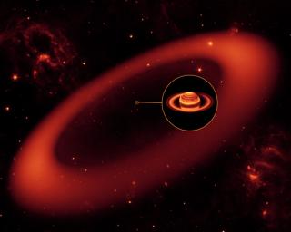 This artist's conception shows a nearly invisible ring around Saturn -- the largest of the giant planet's many rings. It was discovered by NASA's Spitzer Space Telescope.