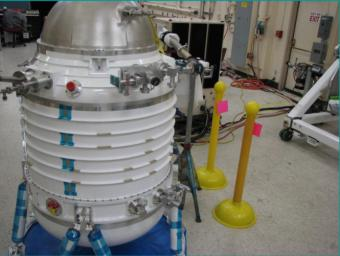 Initial assembly of NASA's Wide-field Infrared Survey Explorer cryostat. The cryostat is a 2-stage solid hydrogen dewar that is used to cool the WISE optics and detectors. Here the cryostat internal structures are undergoing their initial vacuum pumpdown.
