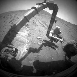 NASA's Mars Exploration Rover Spirit recorded this forward view of its arm and surroundings; bright soil in the left half of the image is loose, fluffy material churned by the rover's left-front wheel as Spirit.