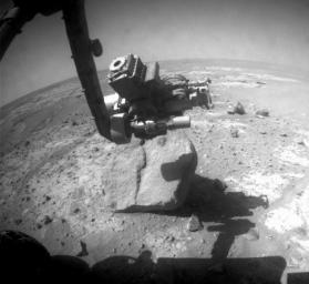 NASA's Mars Exploration Rover Opportunity used the wire brush of its rock abrasion tool to scour dust from a circular target area on a rock called 'Marquette Island.'