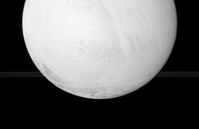 NASA's Cassini spacecraft looks toward the south pole of Enceladus, with a glimpse of Saturns rings in the distance, during the spacecrafts close flyby Nov. 2, 2009.