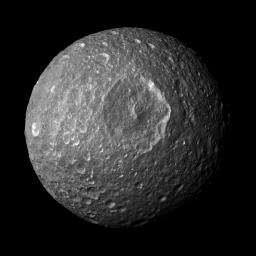 This mosaic, created from images taken by NASA's Cassini spacecraft, looks straight at Saturn's moon Mimas' huge Herschel Crater revealing bright-walled craters, with floors and surroundings about 20 percent darker than the steep crater walls.