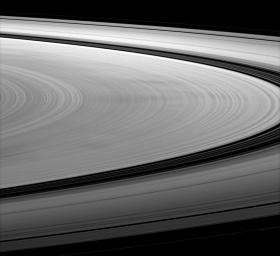 NASA's Cassini spacecraft images dark spokes on Saturn's B ring. Spokes are radial markings on Saturn's rings that continue to interest scientists, and they can be seen here stretching left to right across the image.
