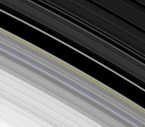 This image obtained by NASA's Cassini spacecraft of the outer edge of Saturn's B ring, reveals the combined effects of a tugging moon and oscillations that can naturally occur in disks like Saturn's rings and spiral galaxies.