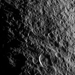 Geologic faults among craters on Saturn's moon Tethys are depicted in this image captured during a flyby of the moon by NASA's Cassini spacecraft on Aug. 14, 2010.