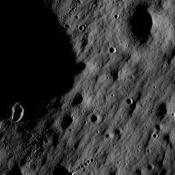 Full resolution detail from one of the first LROC NAC images. At this scale and lighting, impact craters dominate the landscape.