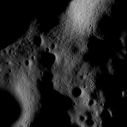 On July 4th the Narrow Angle Camera onboard NASA's Lunar Reconnaissance Orbiter scanned its way towards the north pole at an altitude of 187 km, brushing past the crater Rozhdestvenskiy W.