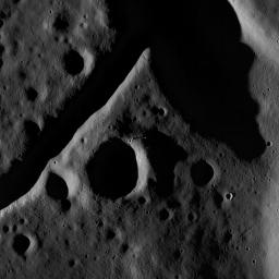 The central peak and fractured floor of Compton crater as imaged by the LROC Narrow Angle Camera onboard NASA's Lunar Reconnaissance Orbiter at dusk, image width is ~1720 meters.