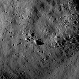 NASA's Lunar Reconnaissance Orbiter's sees hummocks and blocks on the ejecta blanket of Tsiolkovskiy crater.