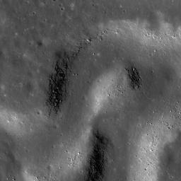 NASA's Lunar Reconnaissance Orbiter's shows a sinuous rille winding its way across a much larger rille in the heart of the Aristarchus Plateau.