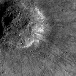 This is a view from NASA's Lunar Reconnaissance Orbiter of a very young impact crater in Balmer basin. The dark streamers are impact melt splashes thrown out during the crater formation.