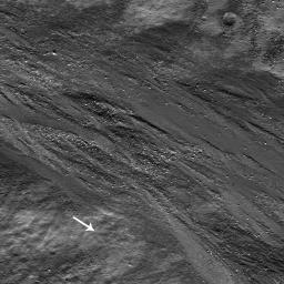 High-albedo marks on the lunar surface left by a boulder bouncing down the northeast wall of farside highlands crater Moore F in this image captured by NASA's Lunar Reconnaissance Orbiter.