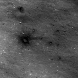 This image from NASA's Lunar Reconnaissance Orbiter shows dark materials excavated by later small impacts show up clearly on the bright ejecta of a small lunar crater to the west.