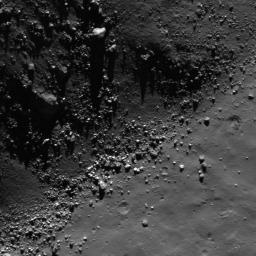 This image from NASA's Lunar Reconnaissance Orbiter shows a view of boulders, on the floor of Rutherfurd crater, about to disappear into the shadows of dusk.