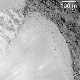 NASA's Lunar Reconnaissance Orbiter captures a debris flow extending down the southwest wall of Janssen K crater.